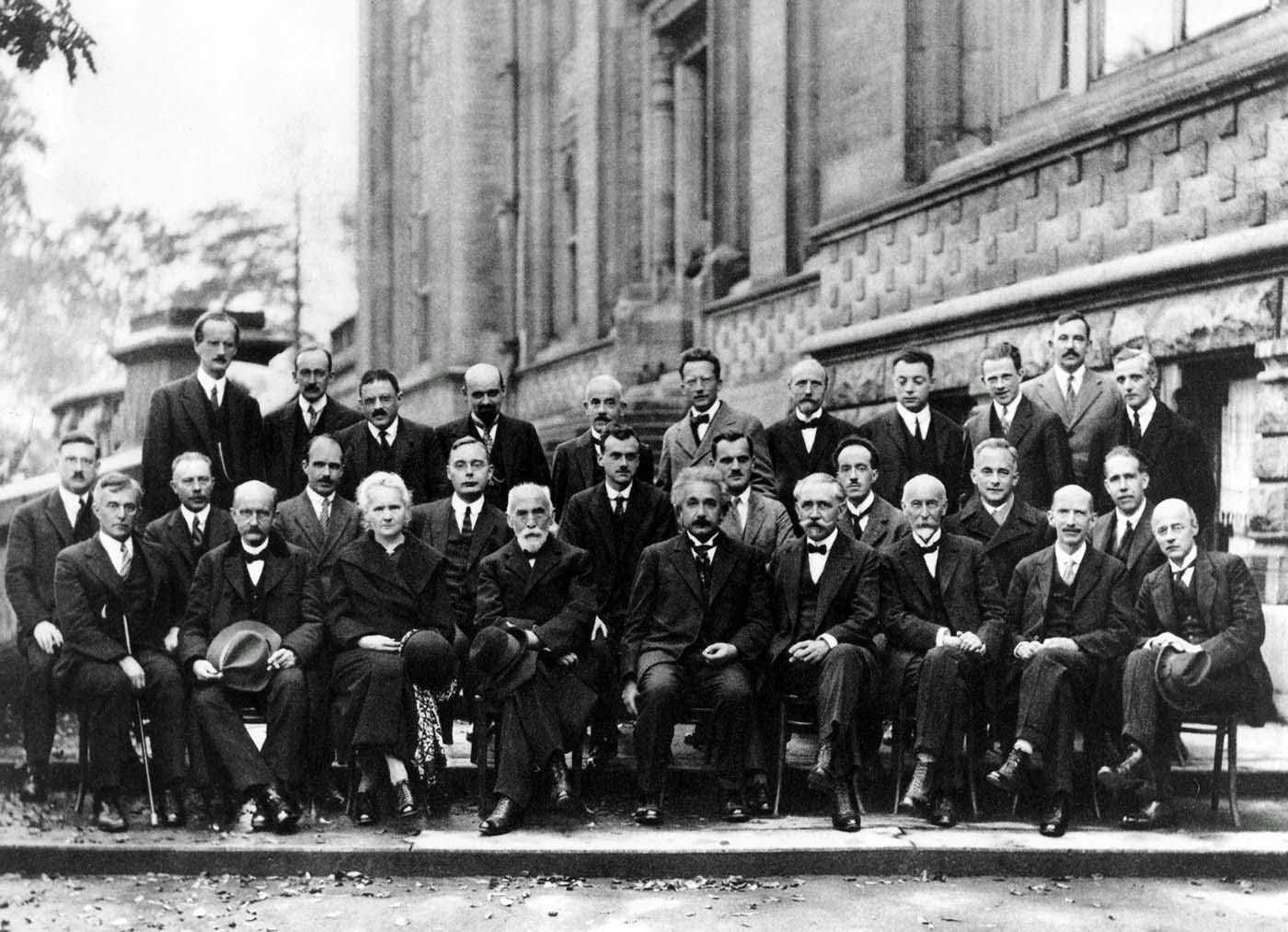 Front row: Irving Langmuir, Max Planck, Marie Curie, Hendrik Lorentz, Albert Einstein, Paul Langevin, Charles-Eugène Guye, C.T.R Wilson, Owen Richardson. Middle row: Peter Debye, Martin Knudsen, William Lawrence Bragg, Hendrik Anthony Kramers, Paul Dirac, Arthur Compton, Louis de Broglie, Max Born, Niels Bohr. Back row: Auguste Piccard, Émile Henriot, Paul Ehrenfest, Édouard Herzen, Théophile de Donder, Erwin Schrödinger, JE Verschaffelt, Wolfgang Pauli, Werner Heisenberg, Ralph Fowler, Léon Brillouin. Curie, the only woman in attendance, was also the only one among them to win a Nobel Prize in two separate disciplines: chemistry and physics.